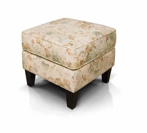 the loren ottoman features a welted box cushion top with a smooth base